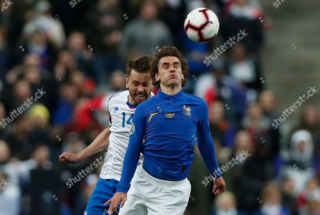 France's Antoine Griezmann (R) and Iceland's Kari Arnason (L) in action during the UEFA EURO 2020 qualifiers group H soccer match between France and Iceland in Paris, France, 25 March 2019.
