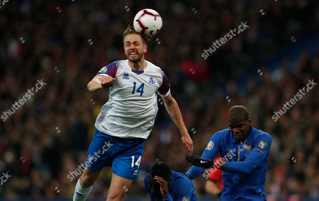 France's Paul Pogba (R) and Iceland's Kari Arnason (L) in action during the UEFA EURO 2020 qualifiers group H soccer match between France and Iceland in Paris, France, 25 March 2019.