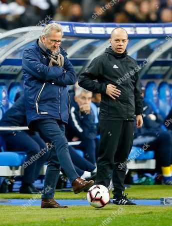 Iceland's coach Erik Hamren stops a ball during the Euro 2020 group H qualifying soccer match between France and Iceland at Stade de France stadium in Saint Denis, outside Paris, France