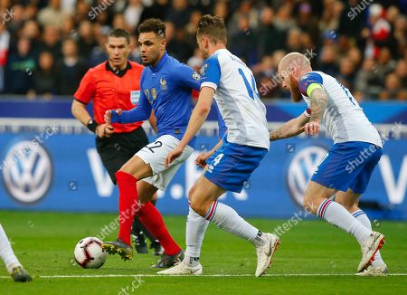 France's Layvin Kurzawa, left, challenges for the ball with Iceland's Kari Arnason during the Euro 2020 group H qualifying soccer match between France and Iceland at Stade de France stadium in Saint Denis, outside Paris, France