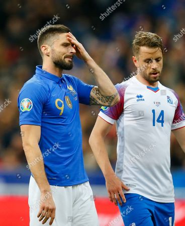 France's Olivier Giroud, left, reacts next to Iceland's Kari Arnason after his team missed an opportunity to score during the Euro 2020 group H qualifying soccer match between France and Iceland at Stade de France stadium in Saint Denis, outside Paris, France