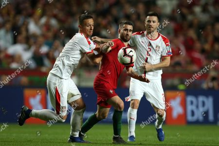 Portugal's Rafa Silva (C) fight for the ball with Serbia's Nemanja Maksimovic (L) and Antonio Rukavina (R) during the UEFA EURO 2020 Group B qualifying soccer match between Portugal and Serbia, at Luz Stadium, Lisbon, Portugal, 25 March 2019.