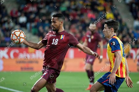 Catalonia's Bojan Krkic (R) in action against Venezuela's Yanguel Herrera (L) during a friendly soccer match between Catalonia and Venezuela in Girona, north eastern Spain, 25 March 2019.
