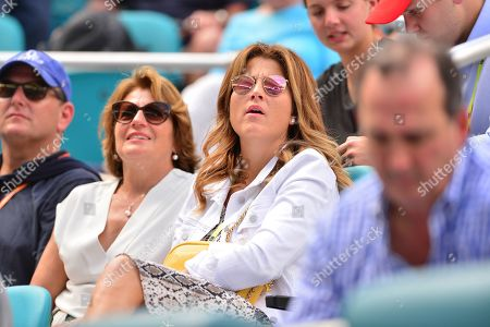 Mother Lynette Federer, wife Mirka Federer watch as Roger Federer, of Switzerland in action against Filip Krajinovic, of Serbia during their match at the Miami Open tennis tournament