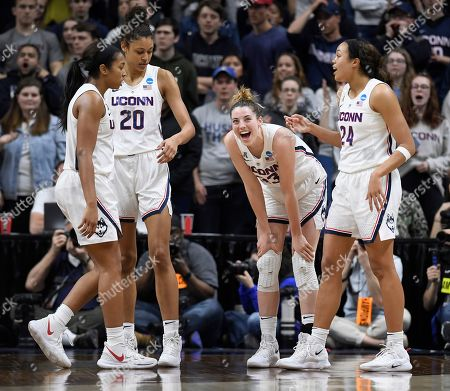 Katie Lou Samuelson, Megan Walker, Olivia Nelson-Ododa, Napheesa Collier. Connecticut's Katie Lou Samuelson, second from right, with teammates Megan Walker, left, Olivia Nelson-Ododa, second from left, and Napheesa Collier, right, during the second half of a second-round women's college basketball game in the NCAA tournament, in Storrs, Conn