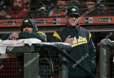 Stock Photo of Oakland Athletics manager Bob Melvin, right, gestures during the seventh inning of an exhibition baseball game against the San Francisco Giants in San Francisco