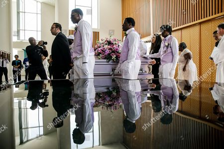 Pallbearers arrive with the casket of Trinity Love Jones, as they attend an interfaith memorial service at St. John Vianney Parish in Hacienda Heights, California, USA, 25 March 2019. The body of Trinity Love Jones, 9-years-old, was found in a duffel bag along a trail in Hacienda Heights this month. Taquesta Graham, 28, a former Long Beach resident, has been in custody without bail since 08 March on a warrant unrelated to her daughter's death. She was extradited from Texas to California last week to answer investigators' questions about Trinity. Graham's boyfriend, Emiel Hunt, 38, has also been charged with murder in the child's death. If convicted, Hunt faces up to 55 years to life in prison. Graham faces a maximum sentence of 26 years to life in state prison if convicted.