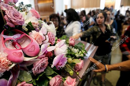 A pair of shoes decorate the bouquet of flowers for the casket of Trinity Love Jones, as community members gather to pay their final respects at St. John Vianney Parish in Hacienda Heights, California, USA, 25 March 2019. The body of Trinity Love Jones, 9-years-old, was found in a duffel bag along a trail in Hacienda Heights this month. Taquesta Graham, 28, a former Long Beach resident, has been in custody without bail since 08 March on a warrant unrelated to her daughter's death. She was extradited from Texas to California last week to answer investigators' questions about Trinity. Graham's boyfriend, Emiel Hunt, 38, has also been charged with murder in the child's death. If convicted, Hunt faces up to 55 years to life in prison. Graham faces a maximum sentence of 26 years to life in state prison if convicted.
