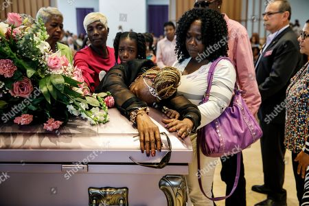 Diana Wilson, grandmother of the late Trinity Love Jones, mourns for her granddaughter during a 'Memorial of Light' service, at St. John Vianney Parish in Hacienda Heights, California, USA, 25 March 2019. The body of Trinity Love Jones, 9-years-old, was found in a duffel bag along a trail in Hacienda Heights this month. Taquesta Graham, 28, a former Long Beach resident, has been in custody without bail since 08 March on a warrant unrelated to her daughter's death. She was extradited from Texas to California last week to answer investigators' questions about Trinity. Graham's boyfriend, Emiel Hunt, 38, has also been charged with murder in the child's death. If convicted, Hunt faces up to 55 years to life in prison. Graham faces a maximum sentence of 26 years to life in state prison if convicted.