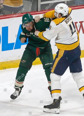 Jordan Greenway, Brian Boyle. Minnesota Wild's Jordan Greenway, left, and Nashville Predators' Brian Boyle exchange punches during the first period of an NHL hockey game, in St. Paul, Minn. Both received fighting majors