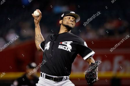 Chicago White Sox starting pitcher Ervin Santana throws to an Arizona Diamondbacks batter during the first inning of a spring training baseball game, in Phoenix