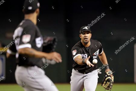 Jose Abreu, Ervin Santana. Chicago White Sox first baseman Jose Abreu, right, tosses the ball to starting pitcher Ervin Santana, left, after fielding a ground ball from Arizona Diamondbacks' Luke Weaver in the third inning of a spring training baseball game, in Phoenix, Ariz. Weaver was out on the play