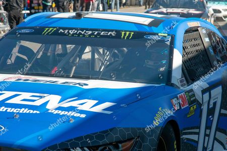 Ricky Stenhouse Jr. passes through the garage area during practice for the NASCAR Monster Energy Cup Series race at Martinsville Speedway in Martinsville, Va