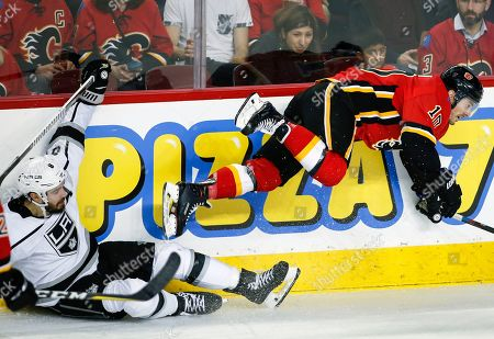 Los Angeles Kings' Drew Doughty, left, sends Calgary Flames' Derek Ryan flying during second-period NHL hockey game action in Calgary, Alberta