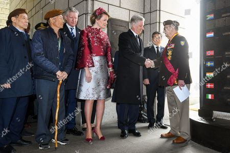 King Philippe and Queen Mathilde and Pieter De Crem during a commemoration ceremony at the Korean War Memorial and a visit to the Belgian Monument including the participation of veterans
