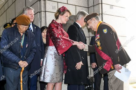 Stock Image of King Philippe and Queen Mathilde and Pieter De Crem during a commemoration ceremony at the Korean War Memorial and a visit to the Belgian Monument including the participation of veterans