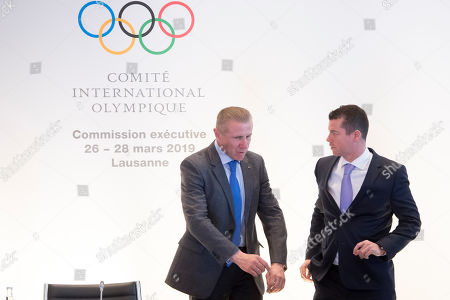 Stock Photo of International Olympic Committee (IOC) Sports Director Kit McConnell, (R), speaks with Ukrainian Sergey Bubka, (L), IOC member and former pole vault world-record holder at the opening of the first day of the executive board meeting of the International Olympic Committee (IOC), in Lausanne, Switzerland, 26 March 2019.