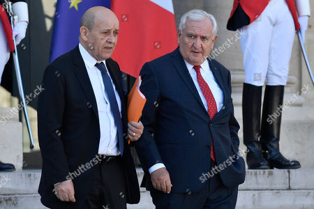 French Foreign Minister Jean-Yves Le Drian and French former Prime Minister Jean-Pierre Raffarin leaves the Elysee Palace after a meeting for talks on building a new global governance in Paris, France, 26 March 2019. Chinese President Xi Jinping is on a three-day state visit to France on the final leg of his European tour.