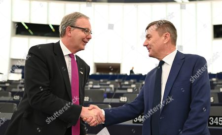 Rapporteur Axel Voss (L) from the Group of the European People's Party (Christian Democrats) shakes hands with European Commissioner for Digital Single Market Andrus Ansip before his speech at the debate on the outcome of negotiations with EU ministers on new rules ensuring that the rights and obligations of copyright law also apply to digital content on the internet at the European Parliament in the European Parliament in Strasbourg, France, 26 March 2019.