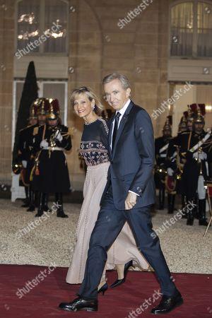 Stock Image of CEO of LVMH Bernard Arnault (R) and his wife French pianist Helene Mercier-Arnault
