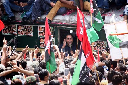 Bilawal Bhutto Zardari (C) chairman of opposition party Pakistan People Party talks with supporters onboard a train, as PPP kicks off train march to protest against the policies of the government, in Karachi, Pakistan, 26 March 2019. Titled as 'Caravan-e-Bhutto', the special train of the Pakistan Railways will reach its final stop in Larkana on 27 March.