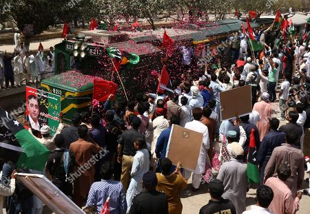 Supporters of opposition party Pakistan People Party gathers to accompany Bilawal Bhutto Zardari, the chairman of PPP as he leads a train march to protest against the policies of the government, in Karachi, Pakistan, 26 March 2019. Titled as 'Caravan-e-Bhutto', the special train of the Pakistan Railways will reach its final stop in Larkana on 27 March.