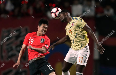 Stock Picture of South Korea's Kim Young-gwon, left, vies for the ball with Colombia's Duvan Zapata during the friendly soccer match between South Korea and Colombia at Seoul World Cup Stadium in Seoul, South Korea