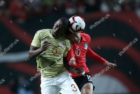 Stock Image of South Korea's Lee Jae-sung, right, vies for the ball with Colombia's William Tesillo during the friendly soccer match between South Korea and Colombia at Seoul World Cup Stadium in Seoul, South Korea