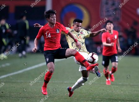 Stock Picture of South Korea's Lee Jae-sung, left, vies for the ball with Colombia's Luis Diaz during the friendly soccer match between South Korea and Colombia at Seoul World Cup Stadium in Seoul, South Korea