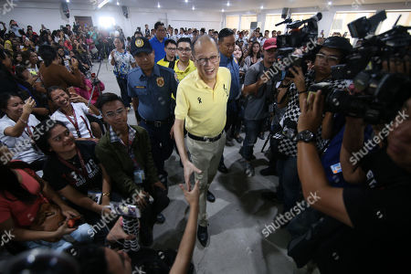 Former Philippine President Benigno Aquino III (C) is greeted by supporters during an election campaign in Cebu city, Philippines, 26 March 2019. According to reports, Aquino visited vote-rich province of Cebu and known as a bailiwick of Aquino's Liberal Party (LP) to lead the campaign of opposition senatorial candidates.