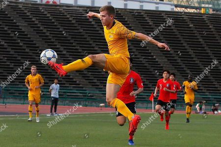 Stock Photo of Australia's Riley McGree (C) in action during the U23 AFC Championship 2020 qualification round soccer match between South Korea and Australia in Phnom Penh, Cambodia, 26 March 2019.