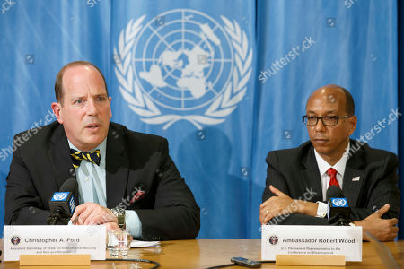 US Assistant Secretary of State for International Security and Non-proliferation Christopher Ashley Ford (L) sitting next to US Disarmament Ambassador Robert Wood (R) informs to media about the relationship between the current security environment and progress on nuclear disarmament, during a press conference at the European headquarters of the United Nations in Geneva, Switzerland, 26 March 2019.