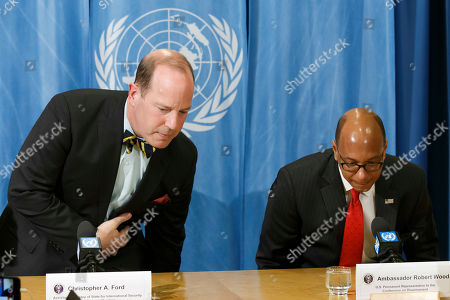 US Assistant Secretary of State for International Security and Non-proliferation Christopher Ashley Ford (L) and US Disarmament Ambassador Robert Wood (R) arrive for a press conference about the relationship between the current security environment and progress on nuclear disarmament, during a press conference at the European headquarters of the United Nations in Geneva, Switzerland, 26 March 2019.