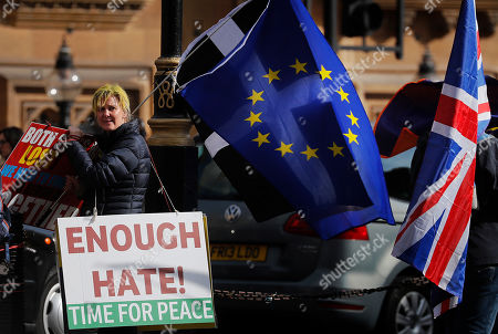 Brexit protesters demonstrate near the House of Parliament in London, . British Prime Minister Theresa May's government says Parliament's decision to take control of the stalled process of leaving the European Union underscores the need for lawmakers to approve her twice-defeated deal