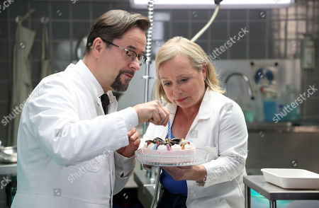 Jan Josef Liefers (L), who plays the role of Forensic Professor Dr. Karl-Friedrich Boerne and German actress Christine Urspruch (R), who plays the role of specialist in forensic medicine Dr. Silke Alberich Haller pose during a photo call in Cologne, Germany, 26 March 2018.