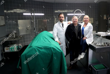 Axel Prahl (C), who plays the role of police inspector Frank Thiel, German actor Jan Josef Liefers (L), who plays the role of Forensic Professor Dr. Karl-Friedrich Boerne and Geran actor ChrisTine Urspruch (R), who plays the role of specialist in forensic medicine Dr. Silke Alberich Haller pose during a phocall in Cologne, Germany, 26 March 2018.