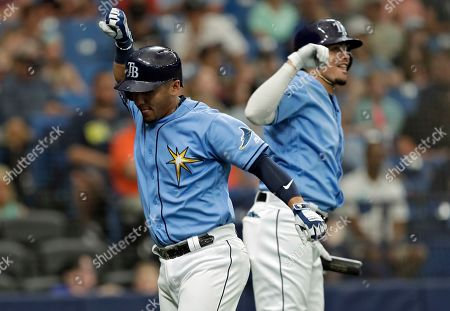 Michael Perez, Willy Adames. Tampa Bay Rays' Michael Perez, left, celebrates with Willy Adames after Perez hit a two-run home run off Detroit Tigers relief pitcher Reed Garrett during the fourth inning of a spring training baseball game, in St.Petersburg, Fla