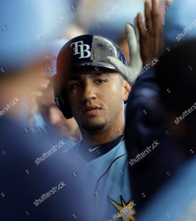 Tampa Bay Rays' Michael Perez celebrates in the dugout after his two-run home run off Detroit Tigers relief pitcher Reed Garrett during the fourth inning of a spring training baseball game, in St. Petersburg, Fla