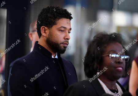 Actor Jussie Smollett looks on during a press conference before leaving Cook County Court after his charges were dropped, in Chicago