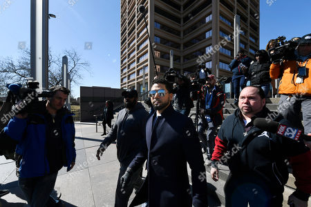 Actor Jussie Smollett leaves Cook County Court after his charges were dropped, in Chicago