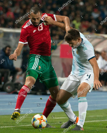 Morocco's Khalid Boutaib (L) in action against Argentina's Walter Kannemann (R) during the International Friendly soccer match between Morocco and Argentina at Ibn Battuta stadium in Tangier, Morocco, 26 March 2019.
