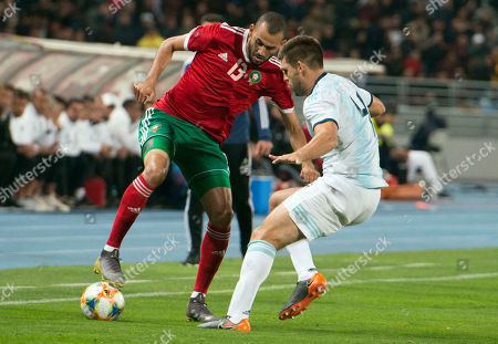 Stock Image of Morocco's Khalid Boutaib (L) in action against Argentina's Walter Kannemann (R) during the International Friendly soccer match between Morocco and Argentina at Ibn Battuta stadium in Tangier, Morocco, 26 March 2019.