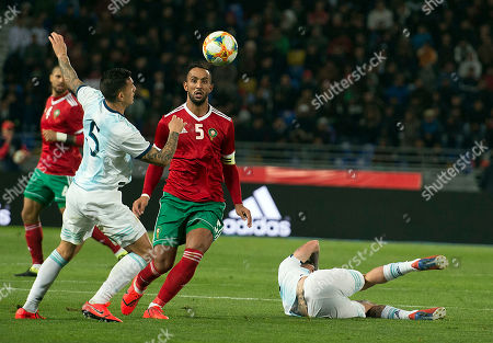 Stock Picture of Morocco's Mehdi Benatia (C) in action against Argentina's Leandro Paredes (L) during the International Friendly soccer match between Morocco and Argentina at Ibn Battuta stadium in Tangier, Morocco, 26 March 2019.