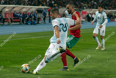 Morocco's Khalid Boutaib (C) in action against Argentina's Guido Rodriguez (L) during the International Friendly soccer match between Morocco and Argentina at Ibn Battuta stadium in Tangier, Morocco, 26 March 2019.