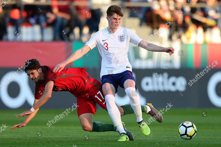 Portugal's Trincao (L) in action against England's Tom Pearce during the Under-20 friendly soccer match between Portugal and England, in Penafiel, Portugal, 26 March 2019.