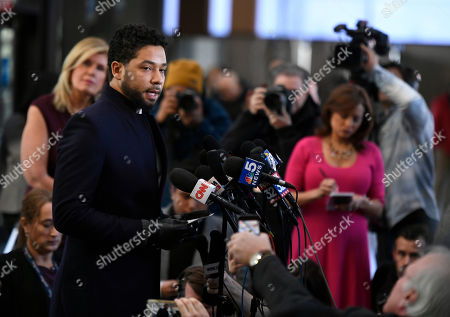 Actor Jussie Smollett talks to the media before leaving Cook County Court after his charges were dropped, in Chicago