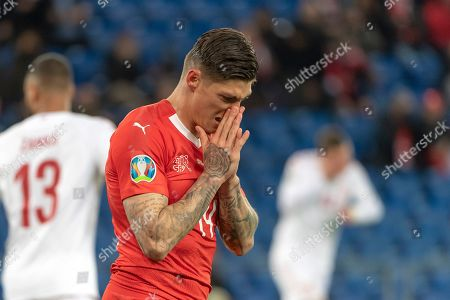 Switzerland's Steven Zuber reacts during the UEFA Euro 2020 qualifying Group D soccer match between Switzerland and Denmark at the St. Jakob-Park stadium in Basel, Switzerland, 26 March 2019.