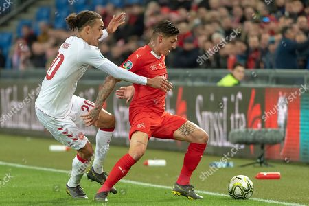 Denmark's Yussuf Poulsen, left, fights for the ball against Switzerland's Steven Zuber, right,  during the UEFA Euro 2020 qualifying Group D soccer match between Switzerland and Denmark at the St. Jakob-Park stadium in Basel, Switzerland, 26 March 2019.
