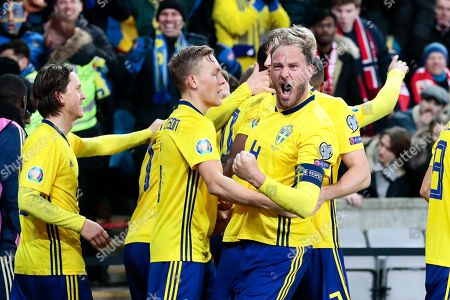 Sweden's  Andreas Granqvist (R) celebrates their third goal during the UEFA EURO 2020 qualifiers match between Norway and Sweden, in Oslo, Norway, 26 March 2019.