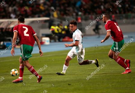 Stock Photo of Morocco's Amrabat Souyan, center, runs betwwen Argentina's Gabriel Mercado, left and German Pezzela during an international friendly soccer match between Morocco and Argentina in Tangier, Morocco